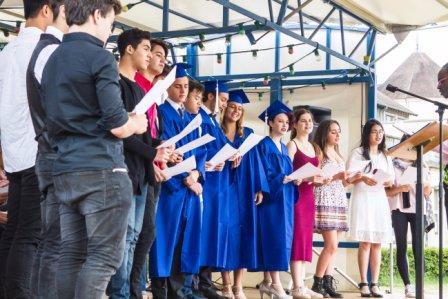 Notre-Dame International High School - students singing together